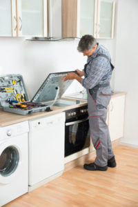 Repair technician checking the stove